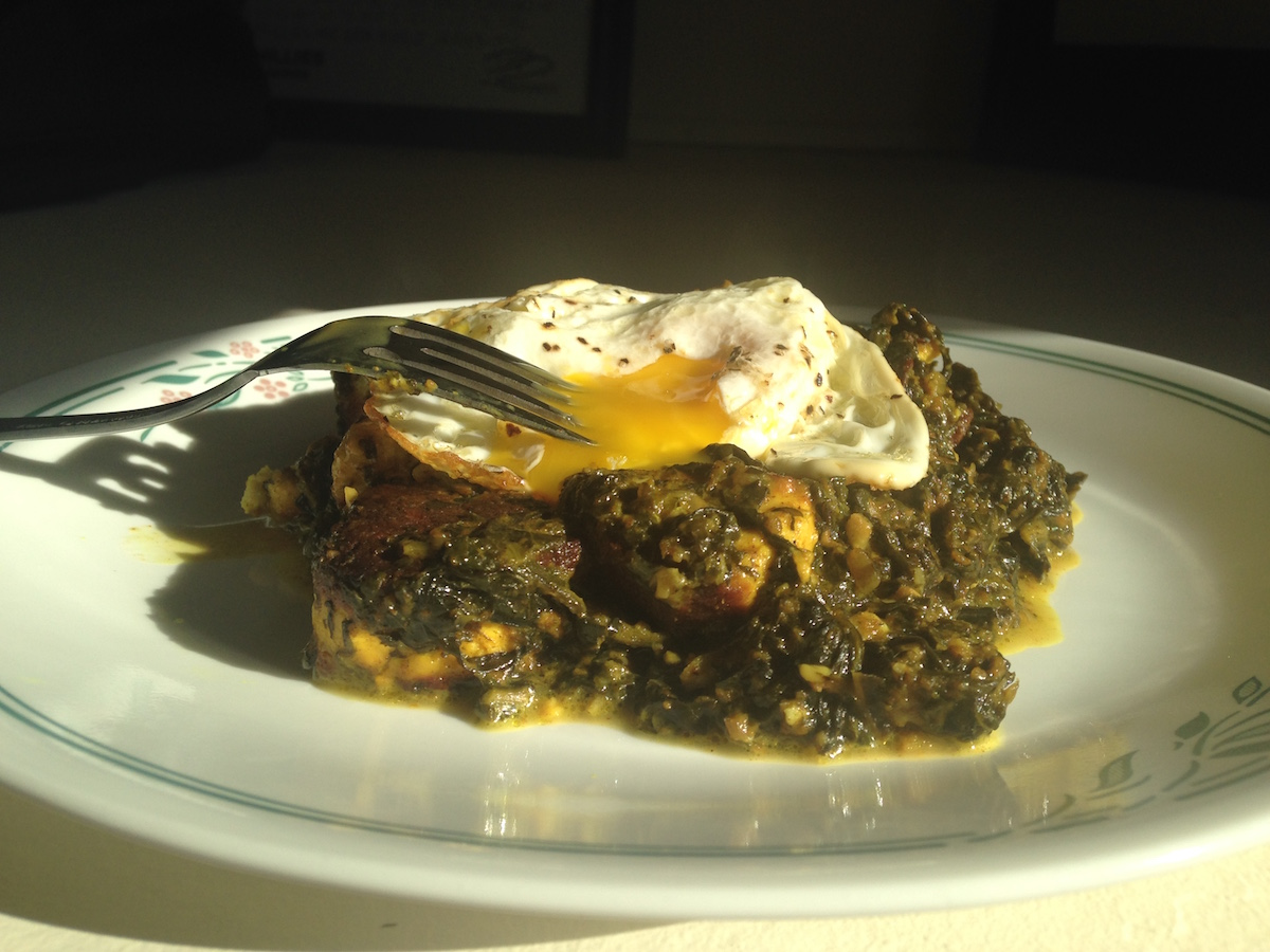 Saag Paneer topped with a runny egg