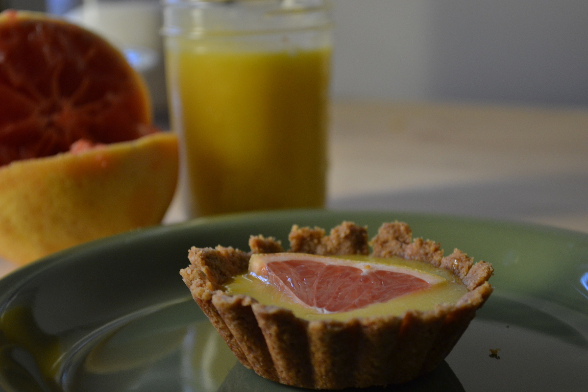 Top tart shells with grapefruit curd. Full recipe on BigTasteTinySpace.com